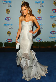 Rebecca is a fashion diva in a silvery corset dress with exquisite ruffled pleats and a mermaid train.