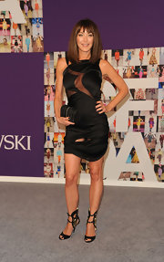 Tamara looked saucy in a sheer-inset LBD with cool cuffed evening sandals.