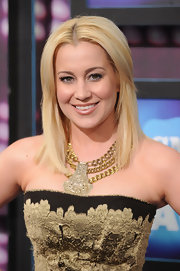 Kellie Pickler showed off her gold statement necklace while hitting the CMT Awards.