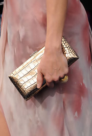 Faith Hill showed off her metallic silver clutch while hitting the red carpet at the CMT Awards.