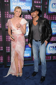 Tim McGraw showed off his cowboy style while hitting the CMT Awards.