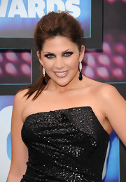 Hillary Scott showed off her dangling gemstone earrings while hitting the CMT Awards.