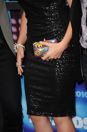 Hilary Scott paired her black sequin dress with a colorful box clutch.