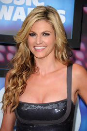 Erin Andrews showed off her long curls while hitting the CMT Awards in a sequin embellished frock.