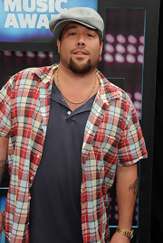 Uncle Kracker paired his casual plaid shirt with a newsboy hat.