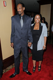 Snoop Dogg walked hand in hand with his wife and high school sweetheart, wearing a classic pinstriped tie.