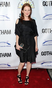 Julianne Moore showed off her buckled clutch while hitting the Comedy For Cure benefit in New York City.