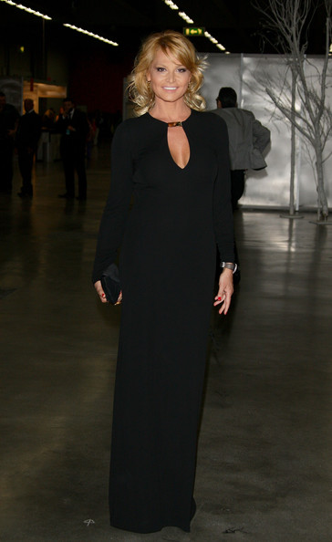 Simona Ventura looked stunning in a simple yet elegant long-sleeve black evening dress with a keyhole neckline.