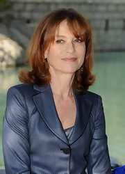 Isabelle Huppert went for a retro vibe at the Dubai International Film Festival with her flip hairstyle.