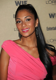 Nicole added a little sparkle to her high ponytail with gemstone earrings.