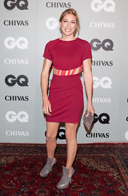 Claudia Karvan paired unexpected gray cutout booties with a red shift dress. A striped belt adds another quirky touch.