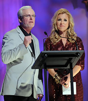 Leigh Anne Tuohy stacked multiple gold bangles to style her sequined gown at the 2010 Inspirational Country Music Awards.
