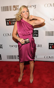 Jane Krakowski paired a stunning fuchsia dress with nude patent platforms.
