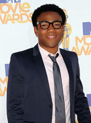 Donald Glover paired this solid blue tie with a matching suit - a winning combo!