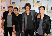 Logan wears his hair longer than the rest of the band and shows off his style with some side swept bangs.