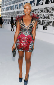 Eva Pigford looked daring in an over-the-top beaded dress with fringe detailing at the MTV Video Music Awards.