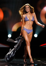 Miss Ireland 2010 Rozanna Purcell showed off her bikini body in this embellished purple halter top bikini.
