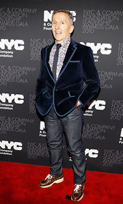 Simon Doonan jazzed up his casual jeans with a navy blue crush velvet blazer.
