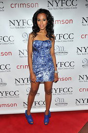 Kerry Washington was true blue in cutout ankle boots. The blue bow-adorned ankle boots were a spectacular choice for her sparkling dress.