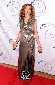 Sophie B. Hawkins wore bold white strappy sandals over sheer black tights. Do you think the shoes work with her metallic dress?