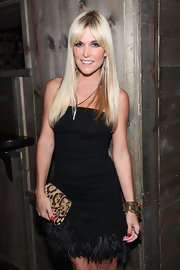 Tinsley Mortimer took a walk on the wild side with a leopard print clutch. She kept her exotic theme going with a feather-embellished strapless dress.