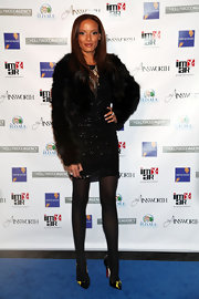 Selita looks ultra glamorous in this long sleeve cropped fur coat. She wore this over a sparkling mini dress and black tights.