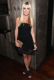 Tinsley Mortimer wore several trends simultaneously in suede cut out booties paired with a feathered dress and of the moment leopard clutch.