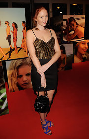 Lily Cole accessorized with a charming sequined black purse when she attended the 2010 Pirelli calendar party.