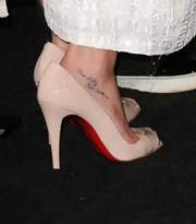 Actress Lea Michele showed off her foot tattoo which reads, Our City Our Love.