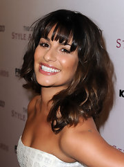 Lea Michele was all smiles on the red carpet. Her brunette tresses were full of volume and texture.