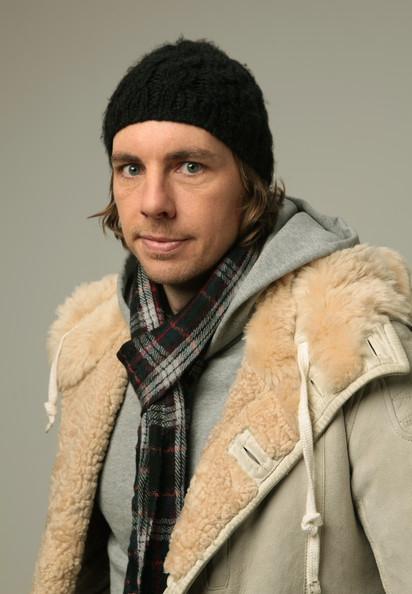 Dax Shepard kept warm at the Sundance Film Festival with a black cable beanie, a scarf, and a fur-lined jacket.