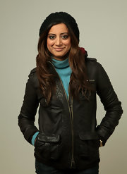 Noureen DeWulf was in her winter gear featuring a black leather jacket at the portrait sessions of 'The Taqwacores.'