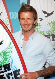 David Beckham showed off his spiked locks while hitting the Teen Choice Awards.