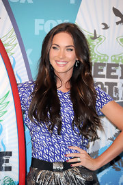 Megan Fox showed off her flowing long locks while walking the red carpet at the Teen Choice Awards.