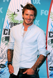 David topped off his casual look with a soft blue button down shirt.