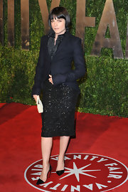 "Selma completed her L'Wren Scott ensemble with a pair of ""Helmut"" black patent leather, pointed-toe pumps."