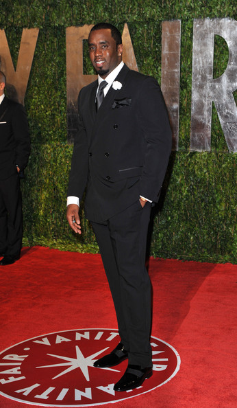 Sean Combs paired black patent leather slip-on shoes with a double-breasted suit for an elegant look during the 2010 Vanity Fair Oscar party.