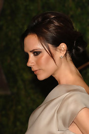 For the 2010 'Vanity Fair' Oscar party, Victoria Beckham wore her hair in a lovely classic bun with plenty of volume through the crown. She left a few face-framing strands to add softness.