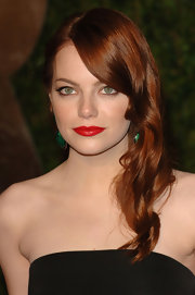 Emma Stone added high glamour to her retro waves with sultry red lips.