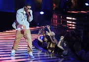 Drake rocks on stage in a baby blue pair of hightop sneakers.