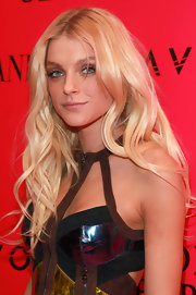 Jessica Stam showed off her radiant blond curls whiele attending the Victoria's Secret Fashion Show. The supermodel completed her look with smoldering taupe eyeshadow.