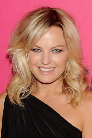Malin Akerman showed off her honey blond curls while attending the Victoria's Secret Fashion show.