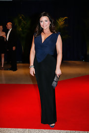 Rachael Ray stunned in an evening gown with a navy and black evening gown with figure-flattering pleating.