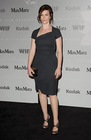 Maggie Siff looked simple yet gorgeous wearing a little black dress with an asymmetric neckline and thick waistband at the 2010 Women in Film Awards.