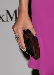 Maggie G paired her fuchsia pink dress with a decadent box clutch.