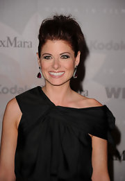Debra Messing paired her off-the-shoulder dress with a messy updo.