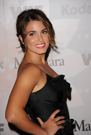 Nikki Reed showed off her elegant side in a loose bun.