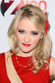 Emily Osment added intensity to her look with a must-have red carpet accessory, bold lashes.