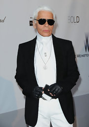 Karl paired his ensemble with black aviator shades.