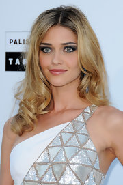 Ana Beatriz Barros styled her hair in large spiral curls and a center part for a swoon-worthy finish at the 2010 amfAR Gala.